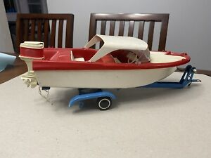 Vintage plastic Tonka Clipper boat,motor,and metal trailer