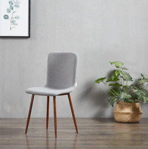 Contemporary hand finished fabric upholstered dining chairs