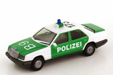 1:87 Mercedes-Benz E-Klasse 300E (W124) Polizei weiß/grün B9 173 - Herpa 4100