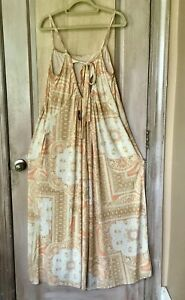 Free People Movement Jumpsuit Overall One Piece Print Wide Leg Orange Tan L NWT