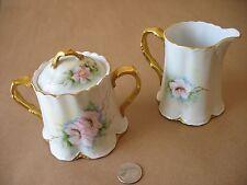 A VTG artist signed Bavaria Germany floral w/gold trim creamer & sugar china set