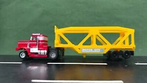 Red & White Tyco 1:64 Scale Peterbilt Slot Truck w/Motor City Transporter