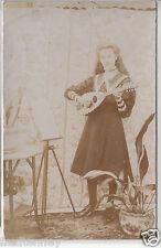 RPPC - Young Girl playing Banjo / Guitar / Ukulele - early 1900s