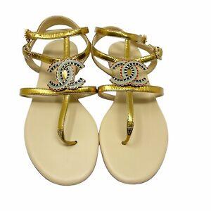new CHANEL Gladiator thong sandals size 37.5 gold metallic enamel CC Logos