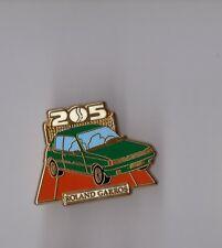 Pin's Roland Garros / peugeot 205 (Zamac signé Arthus Bertrand)