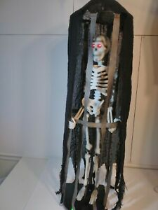 Gemmy Halloween Skeleton in Cage Lights, Sounds, & Vibrating Motion  Collapsible