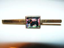 Scotti  Dog  1950's  Gold  Colour Tie  Slide   Black  Dog  On Tartan  Background