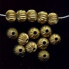 24 VINTAGE BRASS CORRUGATED SQUASHED 6x5mm. ROUND BEADS 2421
