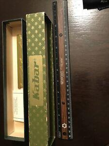 Vintage Kabar knife box and original paperwork. Care Tips And Blank Guarantee.