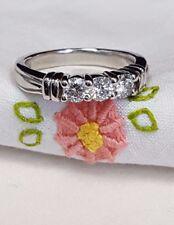 with 3 round brilliant cut diamonds Platinum and diamond custom design band