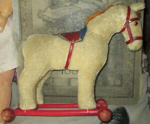 peluche ancienne // cheval sur roulettes//STEIFF?