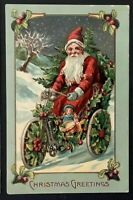 ~Santa Claus in Bike ~Made of  Holly~Doll~Toys~Antique Christmas Postcard~-a998