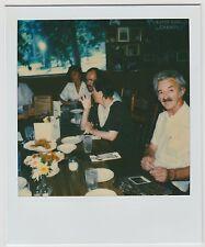 Vintage 80s Polaroid PHOTO Man In Restaurant w/ Polaroid Pic In Front Of Him