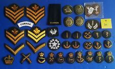 Nice lot  0f 35 + Military Canadian and British  ranks &  patches  ..