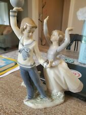 lladro boy and girl with ball