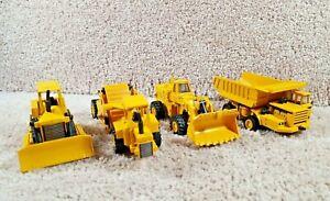 Lot Of 4 ERTL Brand 1/64 Diecast Dump Truck, Wheel Loader, Crawler, Scraper