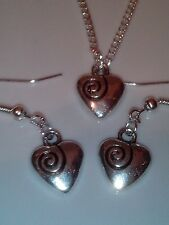 Heart necklace and matching earrings set silver in colour