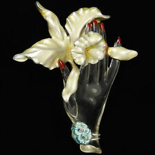 Jelly Belly Hand Holding a Trembler Orchid with Pearl Pin