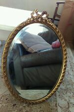Pretty vintage wall hung oval gilt gesso bevelled mirror with bow top