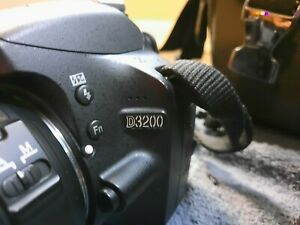 Nikon D3200 with case and nikon DX 55-200mm and 18-55mm lens. Charger/acc.