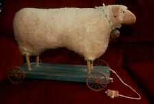 ANTIQUE PRIMITIVE STUFFED SHEEP ON WHEELS PULL TOY