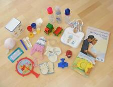 Baby Paket mit Spielsachen Mütze Fläschchen und Zubehör Starter-Set