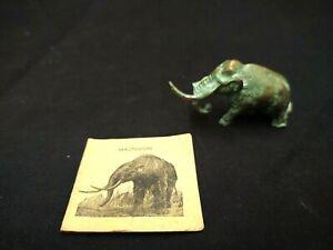 VINTAGE 1940S SRG GREEN BRONZED LEAD METAL MASTODON FIGURINE W/PAPER CARD