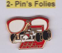 Pin's Folies ** Arthus Bertrand Vuarnet F1 Prost signé AB Paris zamac