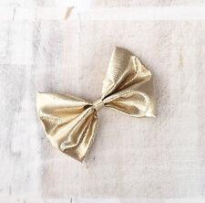 Cute gold lamé metallic hair bow