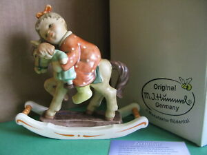 Hummel 2303 Giddy Up! TM-9 In original box. Girl with doll on rocking horse.