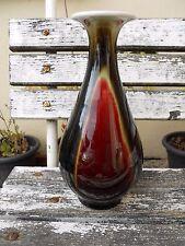 Vase en porcelaine Asiatique couleur sang de boeuf signature à identifier