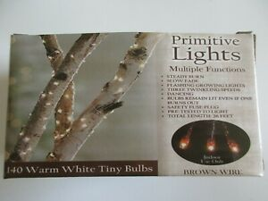 140 Teeny Warm White Bulbs 7 Chase Light Modes Functions with 26' Brown Cord