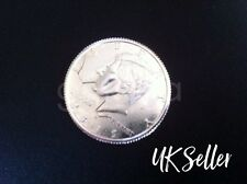 Bitten and Restored Coin (Half Dollar).....Magic Trick