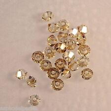50 perles  toupies en cristal de Swarovski  5328 Crystal golden shadow 3 mm