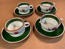 Set of four Stangle Thistle pattern cups and saucers