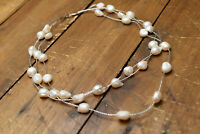 white metal triple strand pearl necklace