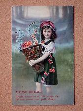 R&L Postcard: Greetings, European Girl & Basket of Flowers