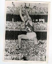 United Press Photos LONDON Finland's VALKAMA Melbourne 1956 long jump