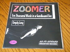"ZOOMER - TEN THOUSAND WORDS IN A CARDBOARD BOX       7"" PINK VINYL PS"