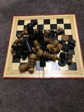 VINTAGE WOODEN CHESS SET AND FOLDING BOARD.
