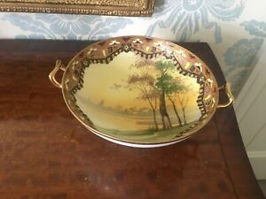 GILT TWIN HANDLED TAZZA WITH RIVER SCENE