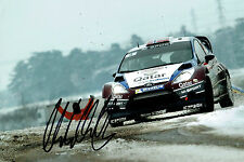 Mads OSTBERG WRC Rally DRIVER SIGNED AUTOGRAPH 12x8 Ford Photo AFTAL COA