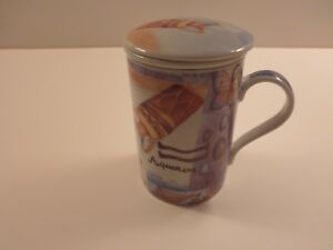 Tea or coffee cup with removable strainer and lid to keep warm from Finland