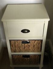 2 Dunelm cream side tables with 2 wicker baskets and 1 drawer