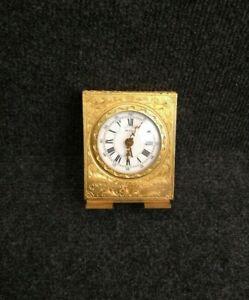 Pendule pendulette Hour Lavigne mouvement mécanique métal doré ciselé
