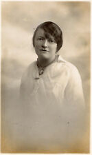 OLD POSTCARD-Lady dressed in white blouse and wearing a large pendant necklace