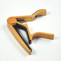Neu Einhand-Gitarren-Triggercapo Quick Change Golden  GY G6B0