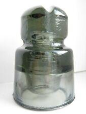 Vintage old glass insulator beige-gray color weak blue swirl