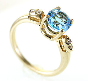 EXQUISITE SWISS BLUE TOPAZ SET IN A14KT YELLOW RING WITH 4 DIAMONDS FINE QUALITY