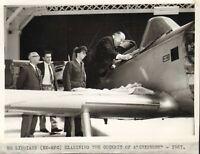 mr liddiard ex - rfc examining the cockpit of a chipmunk 1967 at old sarum